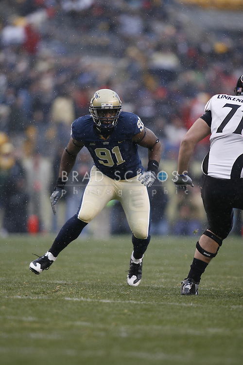 05 DEC 2009: Pittsburgh defensive lineman Greg Romeus breaks through the line during the Panthers devastating 45-44 loss to the Cincinnati Bearcats today at Heinz Field in Pittsburgh, PA.  The win completes a 12-0 undefeated season for Cincinnati and their second consecutive Big East Championship..
