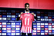 Atletico Madrid's new French midfielder Thomas Lemar holds his jersey during his official presentation at the Wanda Metropolitano Stadium in Madrid on July 30, 2018. - Photo Benjamin Cremel / ProSportsImages / DPPI