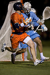 Virginia Cavaliers M/A Steve Giannone (5) in action against UNC.  The Virginia Cavaliers Men's Lacrosse Team defeated the North Carolina Tar Heels 10-9 in overtime at Klockner Stadium in Charlottesville, VA on April 7, 2007.