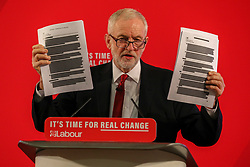© Licensed to London News Pictures. 21/10/2019. London, UK. Jeremy Corbyn holds up redacted documents that are secret talks between the Government and the US on the NHS. Jeremy Corbyn arrive earlier at Church House, London to announce a major statement on the NHS. Photo credit: Alex Lentati/LNP