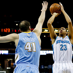 Mar 25, 2013; New Orleans, LA, USA; New Orleans Hornets power forward Anthony Davis (23) shoots over Denver Nuggets center Kosta Koufos (41) during the first quarter of a game at the New Orleans Arena. Mandatory Credit: Derick E. Hingle-USA TODAY Sports