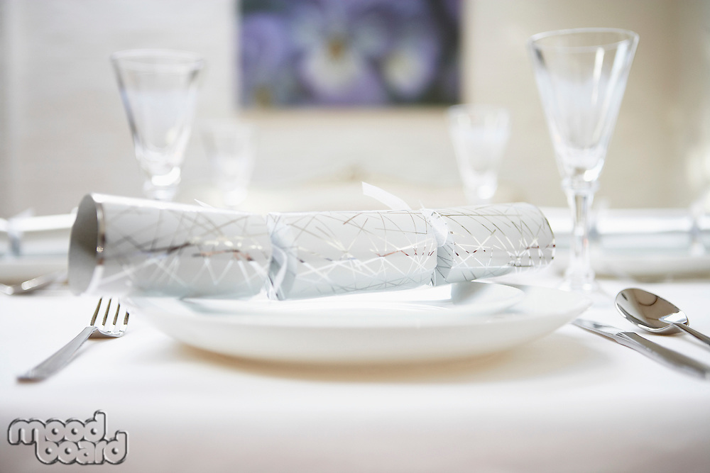 Christmas cracker on Place Setting on table close up