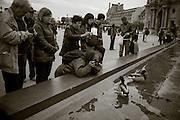 Tourists, Musee du Louvre courtyard. Paris, France. November 23, 2013. Photograph ©2013 Darren Carroll