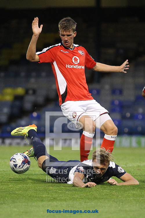Lee Barnard of Southend is fouled by Dean Holden of Walsall in the box but no penalty is awarded during the Capital One Cup First Round match at Roots Hall, Southend<br /> Picture by Paul Chesterton/Focus Images Ltd +44 7904 640267<br /> 12/08/2014