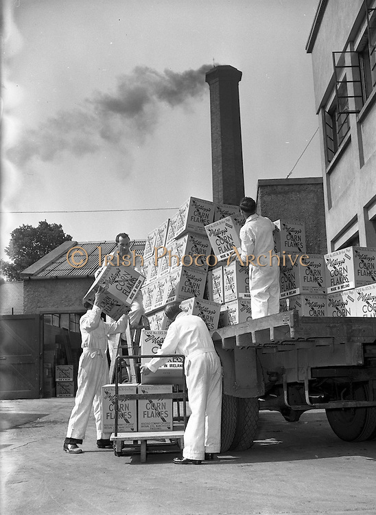 03/06/1954<br /> 06/03/1954<br /> 03 June 1954<br /> Kellogg's factory at Terenure, Dublin. Image shows cases of Corn Flakes being loaded on a truck outside the factory.