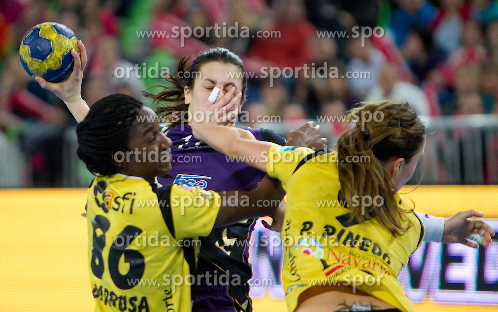 Barbosa Cabral and Saenz Pinedo of Itxako vs Andrea Lekic of Krim during handball match between RK Krim Mercator (SLO) and Itxako Reyno de Navarra (ESP) in Main Round of Women's Champions league, on February  4, 2011 at SRC Stozice, Ljubljana, Slovenia. (Photo By Vid Ponikvar / Sportida.com)
