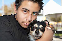 Close-up of a teenage boy with pet dog