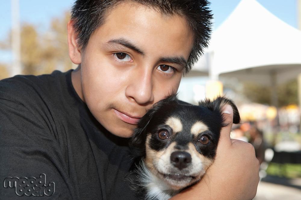 Close-up of a teenage boy with pet dog