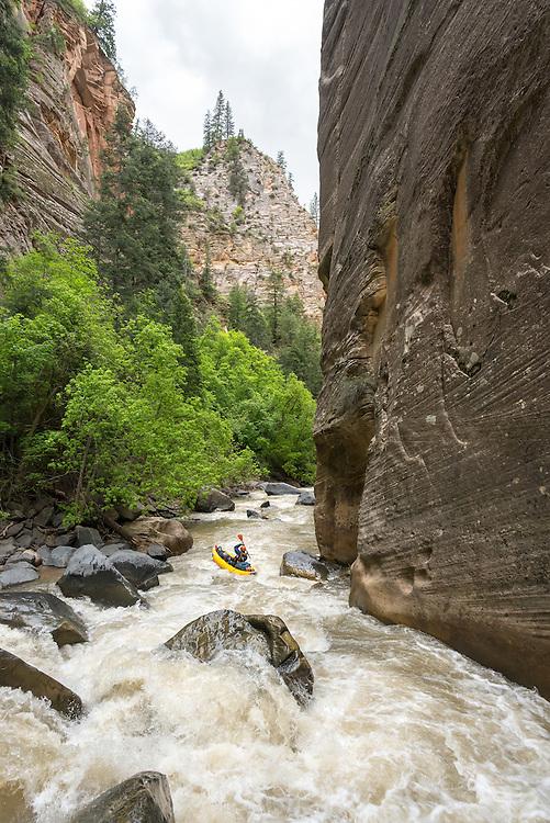 Paddling Deep Creek, Utah in an inflatable kayak.