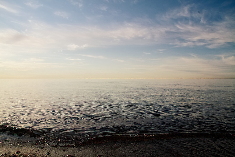 Sunlight from the east reflects off the surface of Lake Ontario in the Beaches neighbourhood of Toronto, Canada.