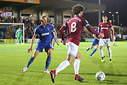 AFC Wimbledon midfielder Scott Wagstaff (7) battles for possession with West Ham United attacker Felipe Anderson (8) during the EFL Carabao Cup 2nd round match between AFC Wimbledon and West Ham United at the Cherry Red Records Stadium, Kingston, England on 28 August 2018.