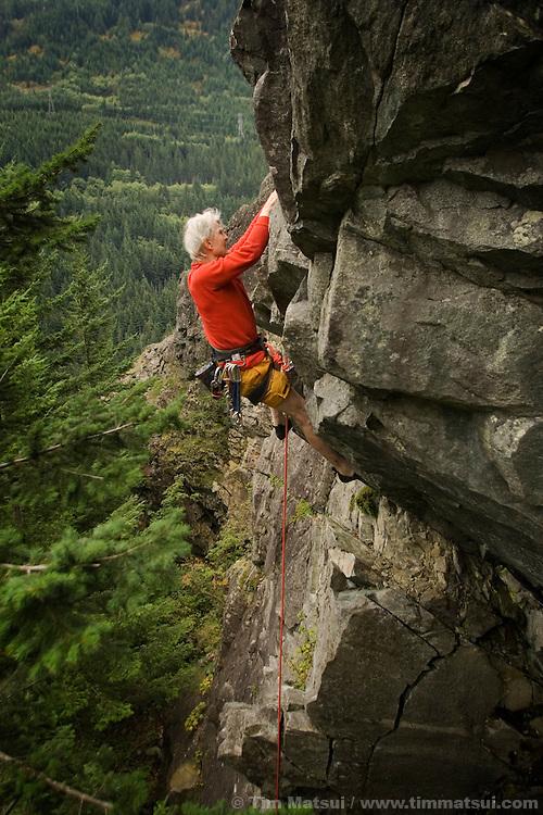 SEATTLE, WA - Stimson Bullitt, at age 86, climbing at the Far Side Wall, Exit 38, near Seattle, Washington, on September 19, 2005. Stimson Bullitt climbing at Exit 38 in Washington.
