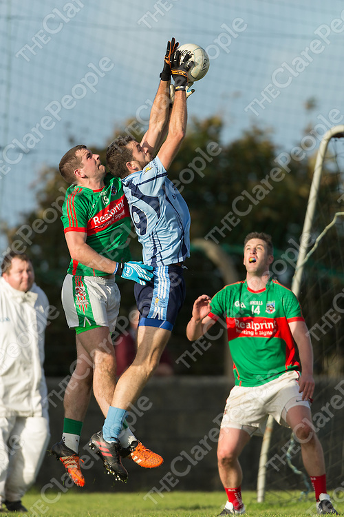Cooraclare's Dermot Tubridy and Kilmurry Ibrickane's Mark McCarthy leap for the ball