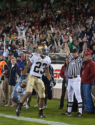 November 28, 2009; Stanford, CA, USA; Notre Dame Fighting Irish wide receiver Golden Tate (23) scores a touchdown during the first quarter against the Stanford Cardinal at Stanford Stadium.   Stanford defeated Notre Dame 45-38.