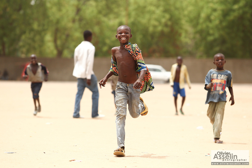 A boy runs towards the camera in N'Djamena, Chad on Tuesday June 8, 2010.