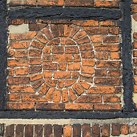Unusual brick pattern in historic tudor building in Faversham, Kent, England