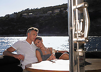 Couple Drinking Champagne on Boat