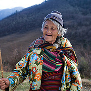 Old Bhutanese woman from a village of central Bhutan, Gangtey, Bhutan, Asia