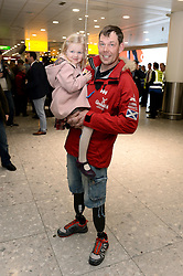 Duncan Slater from team Glenfiddich returns home to meet his daughter Lilly, 3.<br /> The Walking With the Wounded South Pole Allied Challenge 2013 teams return to Heathrow Airport after successfully reaching the South Pole.<br />  Monday, 23rd December 2013. Picture by Ben Stevens / i-Images