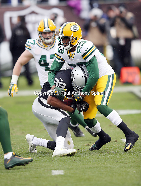 Oakland Raiders wide receiver Amari Cooper (89) gets tackled by Green Bay Packers rookie cornerback Damarious Randall (23) during the 2015 week 15 regular season NFL football game against the Green Bay Packers on Sunday, Dec. 20, 2015 in Oakland, Calif. The Packers won the game 30-20. (©Paul Anthony Spinelli)