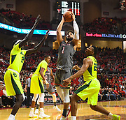 LUBBOCK, TX - DECEMBER 29: Brandone Francis #1 of the Texas Tech Red Raiders goes to the basket against Nuni Omot #21 of the Baylor Bears and King McClure #22 of the Baylor Bears during the game on December 29, 2017 at United Supermarket Arena in Lubbock, Texas. Texas Tech defeated Baylor 77-53. (Photo by John Weast/Getty Images) *** Local Caption *** Brandone Francis;Nuni Omot;King McClure