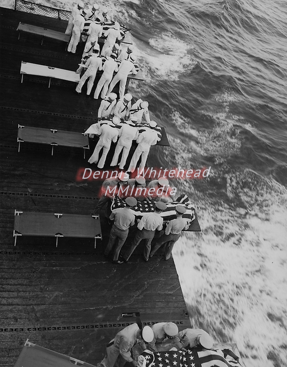 January 23, 1945 - Mass burial service for personnel killed when a 500-pound bomb exploded on the flight deck of the USS Hancock.