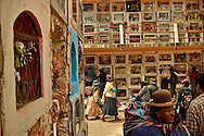 People visit the tombs of their loved ones on Day of the Dead at the General Cemetery in La Paz, Bolivia. As is tradition, many people left food, flowers and baggies of dried coca leaves for the dead. President Evo Morales, a former coca-growers union leader whose administration has done a lot to defend the production and use of coca for traditional purposes, like tea and chewing.