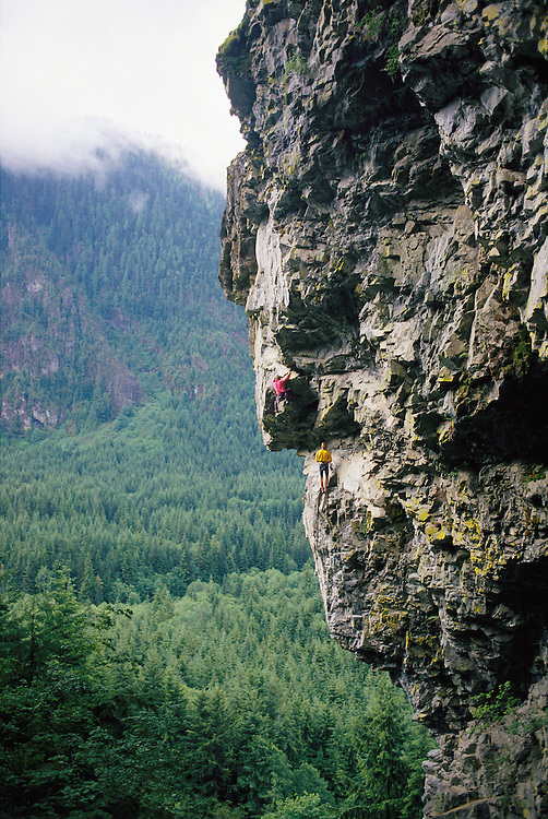 Two men rock climbing in the central Cascade Mountains Washington USA&amp;#xA;<br />