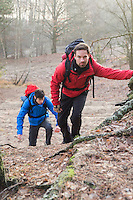 Young hikers trekking in forest