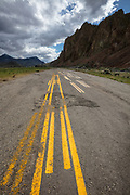 Road line test strip in Central Idaho near Mackay with dramatic storm clouds brewing in the background