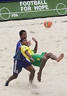 Football - FIFA Beach Soccer World Cup 2006 - Group A - BRA X JPN - Rio de Janeiro - Brazil 05/11/2006<br />Andre - Brazil - performs a scissors-kick next to Masahito Toma from Japan   Event Title Board Mandatory Credit: FIFA / Ricardo Moraes