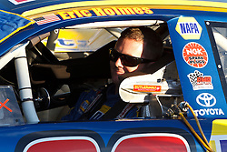 ROSEVILLE, CA - OCTOBER 13: Eric Holmes, driver of the #20 NAPA Auto Parts Toyota sits in his car during qualifying for the NASCAR K&N Pro Series West Toyota/NAPA 150 at the All American Speedway on October 13, 2012 in Roseville, California. (Photo by Jason O. Watson/Getty Images for NASCAR) *** Local Caption *** Eric Holmes