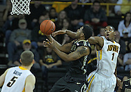 December 28, 2011: Iowa Hawkeyes forward Melsahn Basabe (1) tries to block a shot by Purdue Boilermakers guard Terone Johnson (0) during the NCAA basketball game between the Purdue Boilermakers and the Iowa Hawkeyes at Carver-Hawkeye Arena in Iowa City, Iowa on Wednesday, December 28, 2011. Purdue defeated Iowa 79-76.