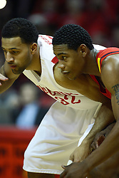 11 December 2010: Brad Birton and Jackie Carmichael ready on the lane during an NCAA basketball game between the Illinois - Chicago Flames (UIC) and the Illinois State Redbirds (ISU) at Redbird Arena in Normal Illinois.