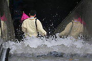 BEIJING, CHINA - JULY 20: <br /> <br /> Citizens walk down escalator stairs while water pours down to subway station on July 20, 2016 in Tianjin, China. Tianjin Meteorological Observatory has issued an orange alert to heavy rainfall at 08:07 am early Wednesday and the rainstorm is predicted to continue in following six hours.<br /> ©Exclusivepix Media
