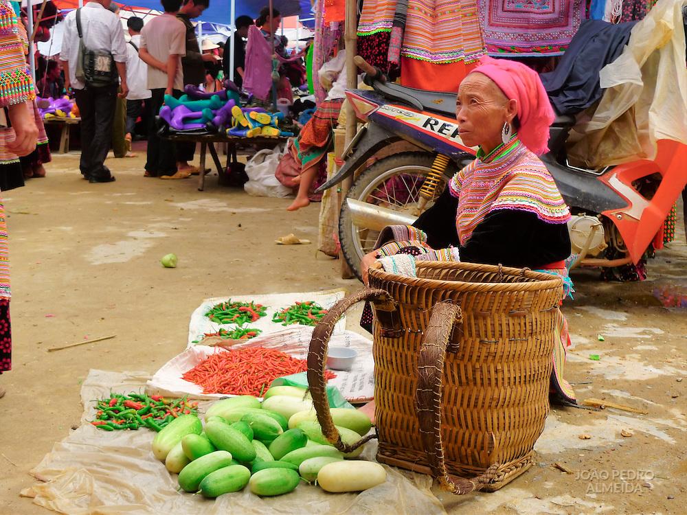 Woman selling at Bac ha market