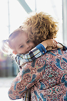 Portrait of woman reuniting with her daughter in airport