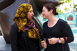 © Licensed to London News Pictures. 06/07/2015. London, UK. 7/7 survivor Gill Hicks talking to Sughra Ahmed outside King's Cross station on Monday, July 6, 2015 before walking to Tavistock Square with faith leaders to commemorate the 10th anniversary of 7/7 bombings by remembering those who lost their lives, as well as offering a message of peace and unity between people of different faiths and backgrounds. Photo credit: Tolga Akmen/LNP