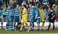 Photo: Ed Godden.<br />Reading v Preston North End. Coca Cola Championship. 25/02/2006. Reading's Dave Kitson lies injured after colliding with Preston keeper Carlo Nash.