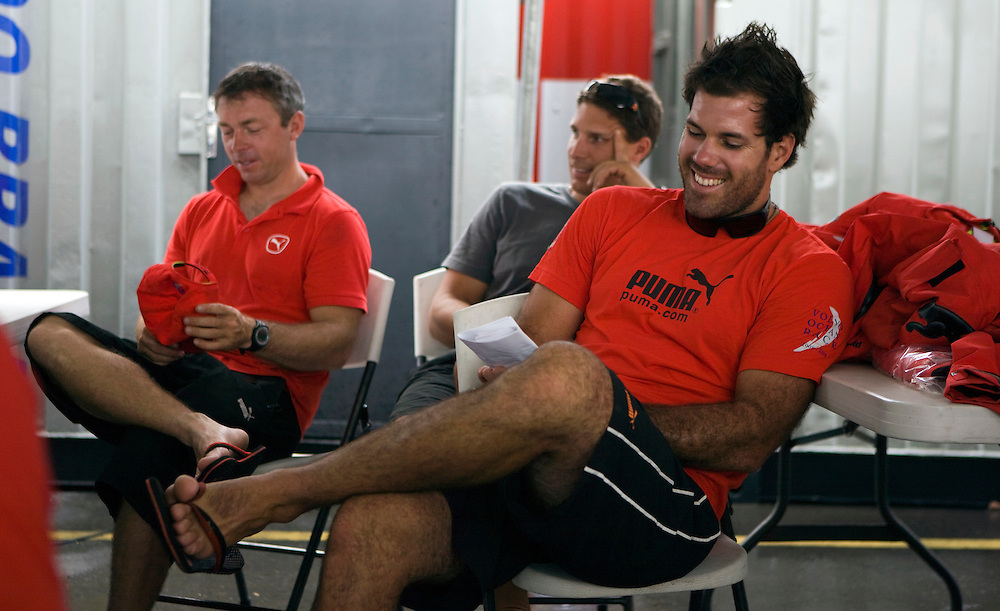 09APR09 From left, PUMA Ocean Racing's Rob Greenhalgh, Justin Ferris and Shannon Falcone in a team meeting in Rio de Janeiro
