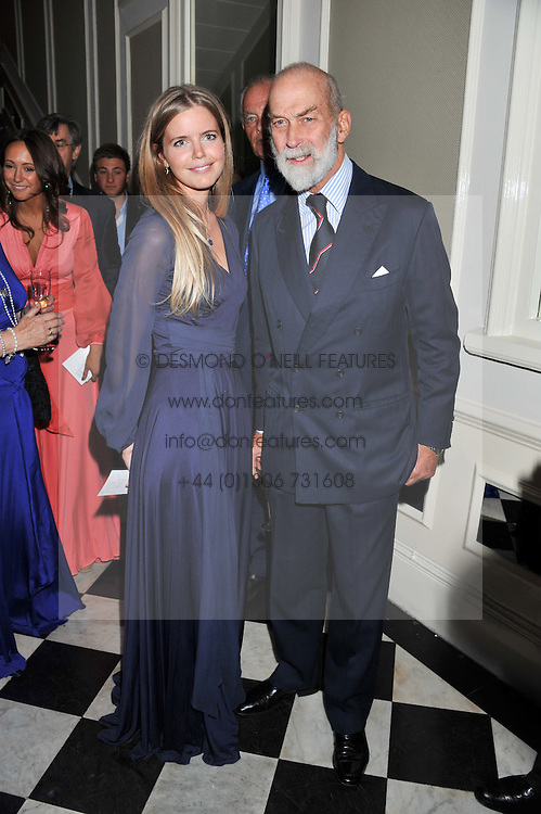 KATIE READMAN and HRH PRINCE MICHAEL OF KENT at a reception hosted by Beulah London and the United Nations to launch Beulah London's AW'11 Collection 'Clothed in Love' and the Beulah Blue Heart Campaign held at Dorsia, 3 Cromwell Road, London SW7 on 18th October 2011.