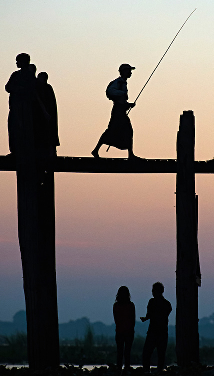 A fisherman going home over the bridge at sunset U-Bien in Myanmar.