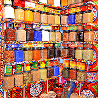Spice Jars in Egyptian Market at Aswan, Egypt<br /> The Nile River floods during most summers. This seasonal event brings rich nutrients that fertilize the valley around Aswan, Egypt, and make the land ideal for farming. Since 1970, these waters have been controlled by the High Dam. Nearby, reachable by a boat called a felucca, is a traditional market filled with textiles, clothing and spices like these on display. But watch out: I was almost stampeded by a runaway camel.