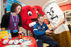 Big Cig and Hearty check Sheffield Wednesday footballer Marnick Vermijl carbon monoxide lung test reading with the help of Rebekah Jepson the NHS Stop Smoking advisor at the Sheffield City Centre BHF Furniture & Electrical Store as part of Stop Smoking Sheffield No smoking Day Campaign<br /> <br /> 2 March 2015<br /> Image © Paul David Drabble <br /> www.pauldaviddrabble.co.uk