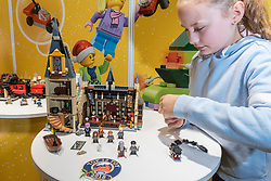 "© Licensed to London News Pictures. 14/11/2018. LONDON, UK. Isabella, aged 10, plays with Harry Potter Hogwarts Great Hall by LEGO.  Preview of ""DreamToys"", the official toys and games Christmas Preview, held at St Mary's church in Marylebone.  Recognised as the countdown to Christmas, the Toy Retailer's Association, an independent panel of leading UK toy retailers, have selected the definitive and most authoritative list of what toys will be the hottest property this Christmas. [Child models provided by show organisers, permission obtained to be photographed].  Photo credit: Stephen Chung/LNP"