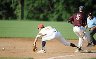 Northampton first baseman Dan Ng #9 bobbles the ball as Falls Justin Jacko #5 makes it safely to first base in the 5th inning at Cairn University Tuesday July 14, 2015 in Langhorne, Pennsylvania.  (Photo by William Thomas Cain)