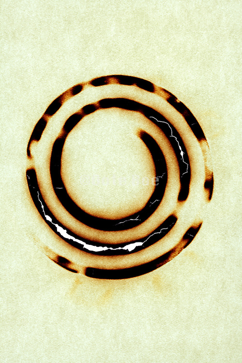 blank paper burned with a circular imprint