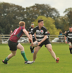 Ballinrobe's out-half Dave Reilly sets up an attack during the Junior league match against Corrib on sunday last.<br /> Pic Conor McKeown
