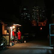Shanghai, China: Neighborhood in the evening near Nanjing Xi Lu. Jose More Photography