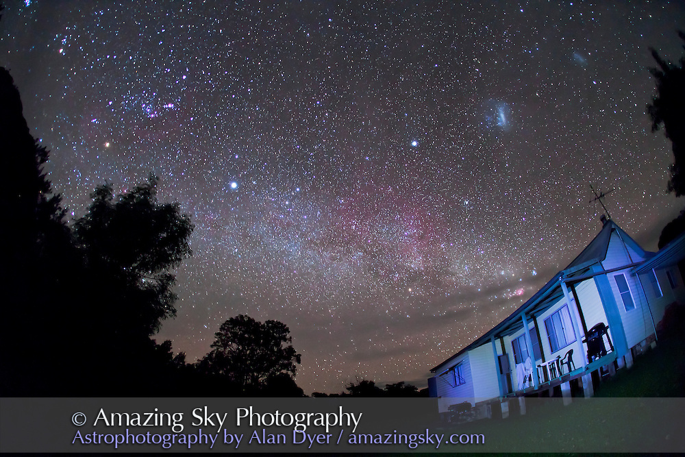 Southern Milky Way over Timor Cottage, with Orion at left and Sirius and Canopus at centre, and Magellanic Clouds at upper right. Shot near Coonabarabran, NSW, Australia, December 6, 2010. Taken with Canon 5D MkII camera and 15mm lens, for 45 seconds at f/2.8 and ISO 3200.